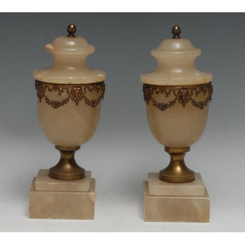 3325 - A pair of French Neo-Classical design gilt metal mounted alabaster mantel urns, acorn finials, each ...