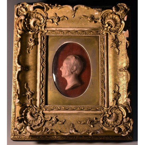 3093 - A 19th century wax portrait, of a gentleman, in profile facing to dexter, 7cm x 5cm, inscribed to ve...