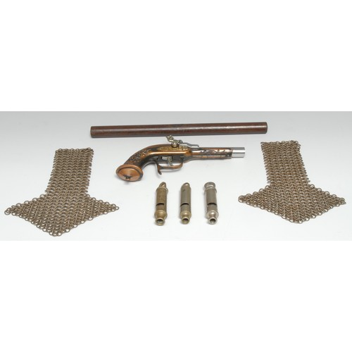 3314 - A pair of chainmail epaulets, 20cm long; a police whistle, The Metropolitan Patent, Isle of Man Cons...