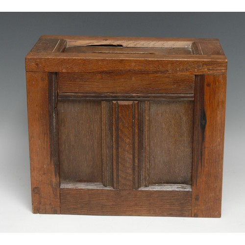 3069 - A 19th century oak ballot box, constructed from salvaged sections of period panelling, 26cm  high, 3...