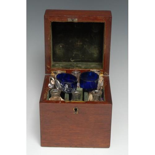3674 - Medical - a 19th century mahogany rectangular apothecary box, hinged cover enclosing an arrangement ...
