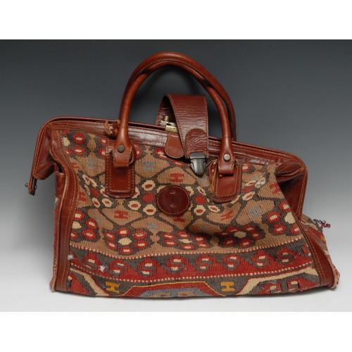 3639 - Luggage - a brown leather mounted kilim Gladstone bag, 47cm wide