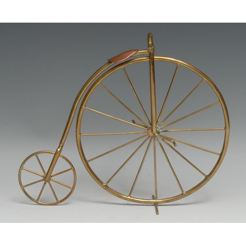 3589 - Cycling - a brass and copper desk model, of a penny farthing or ordinary bicycle, 22cm high