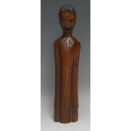 3742 - An Indian Colonial figure, carved half-length as a moustached gentleman wearing a kurta, 31.5cm long...