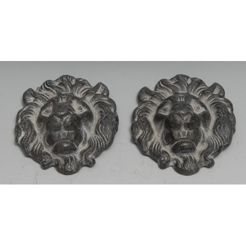 3304 - A pair of 19th century lead bosses, as lion masks, 8cm long