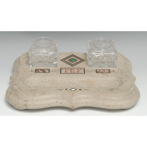 3079 - A 19th century pietra dura shaped rectangular inkstand, inlaid in polished limestone with malachite ...