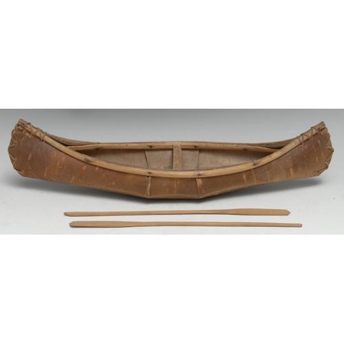 3833 - A Native American birch bark model, of an Algonquin canoe, 37.5cm long, first half 20th century