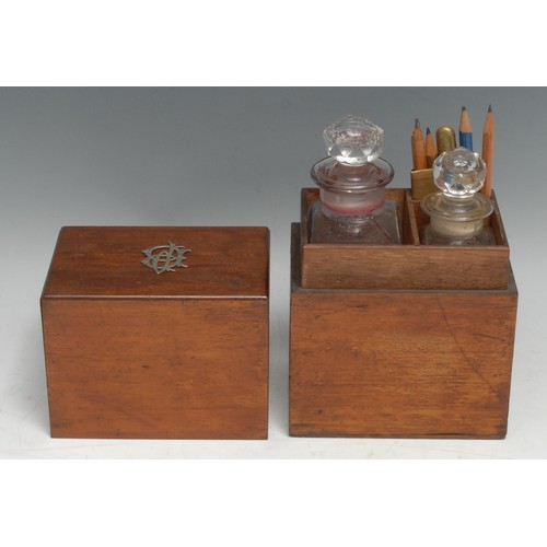 3494 - An early 20th century mahogany rectangular travelling decanter box, the push fitting cover enclosing...