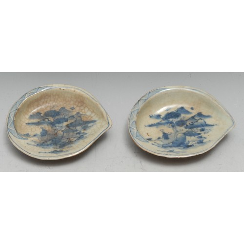 3214 - A pair of Japanese porcelain brush washers, each as an abalone shell, painted in tones of underglaze...