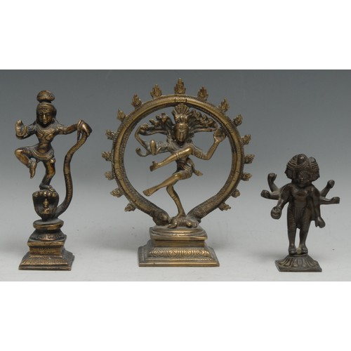 3528 - An Indian brass shrine figure, of Shiva Nataraja, rectangular base, 18.5cm high; an Indian bronze tr...