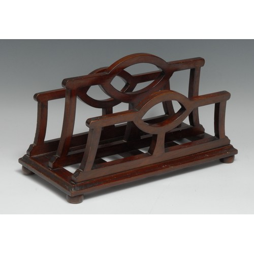 3557 - An unusual Edwardian mahogany table top canterbury periodical rack, shaped divisions, bun feet, 31.5...