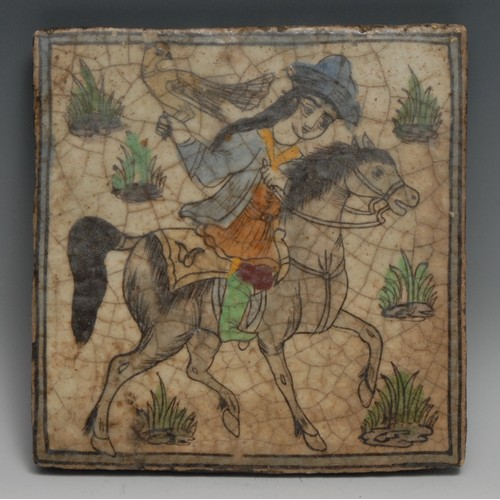 3363 - A Qajar tile, painted with a Persian falconer on horseback, 24.5cm x 24cm, 19th century