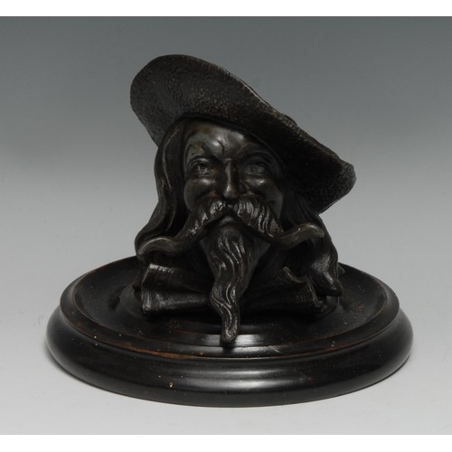 3243 - A late 19th century novelty inkwell, as the head of a musketeer, with broad hat, moustache and beard...