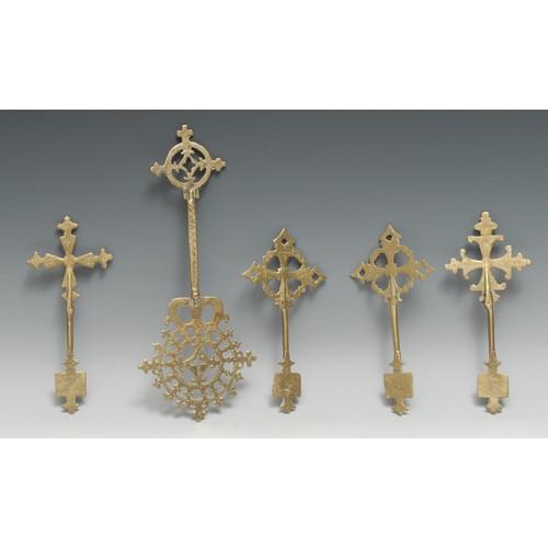 3518 - An Ethiopian Coptic brass cross, 30cm long, 19th century; others, similar (5)