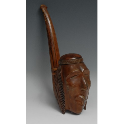 3559 - An unusual hardwood oversize pipe, the bowl carved as the head of a Native American, 33cm long