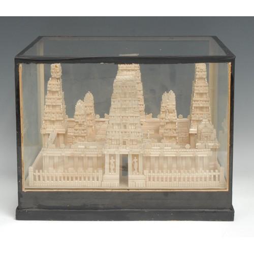 3539 - An Indian pith model, of a temple, possibly Ekambareswarar, Kanchipuram, glazed case, 24cm high, 30....