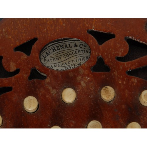 3026 - A 19th century concertina, by Lachenal & Co, London, twenty-one buttons, steel reeds, fretwork ends,...