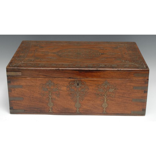 3231 - A large Indian hardwood and brass marquetry rectangular vanity box, profusely inlaid with vases, flo...