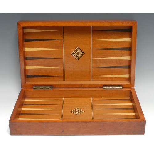 3058 - A 19th century mahogany and parquetry rectangular games box, inlaid for chess, the interior with bac...