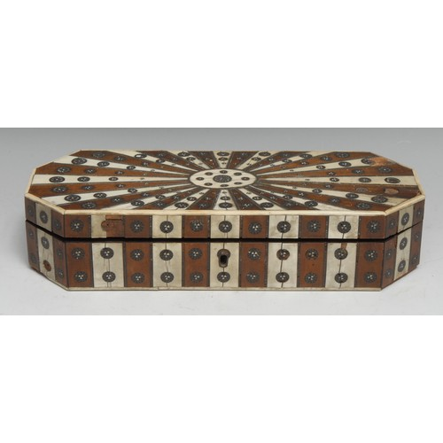 3469 - An early 19th century Anglo-Indian hardwood and ivory parquetry canted rectangular box, veneered wit...