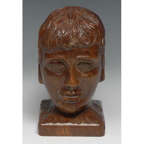 3548 - An oak folk art bust or newel post, carved as the head of a young man, 20cm high, 19th/early 20th ce...