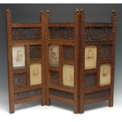 3537 - An Indian hardwood three-fold screen, each panel pierced with lotus and trellis, and with rectangula...