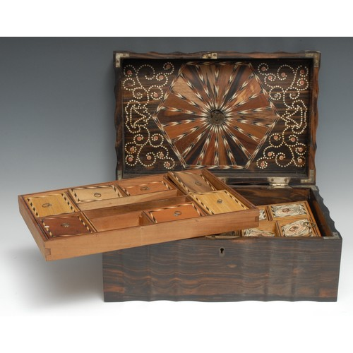 3007 - A 19th century Anglo-Indian/Ceylonese commode shaped work box, hinged cover enclosing a marquetry in...
