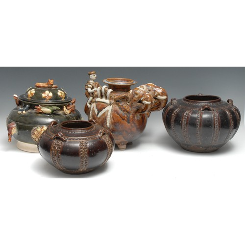 3132 - A Chinese figural vessel, modelled in the Archaic manner with a pair of elephants and a climbing fig...