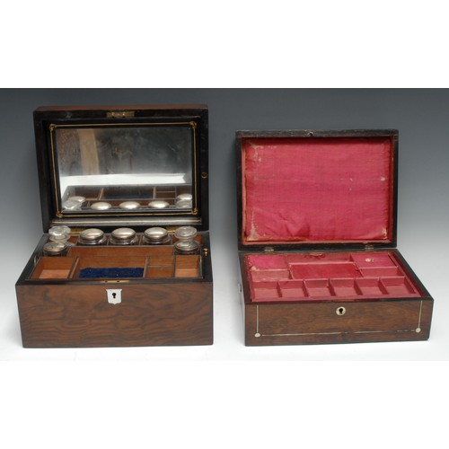 3427 - A Victorian walnut rectangular dressing box, hinged cover enclosing a mirror and an arrangement of b...