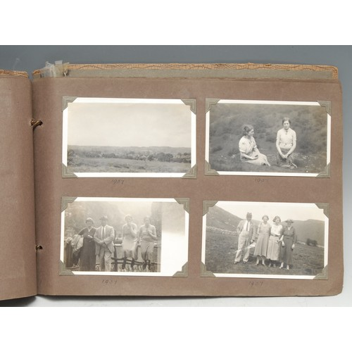 4094 - Photography, Local Interest - a 1930s family photograph album, b/w snapshots generally of British ho...