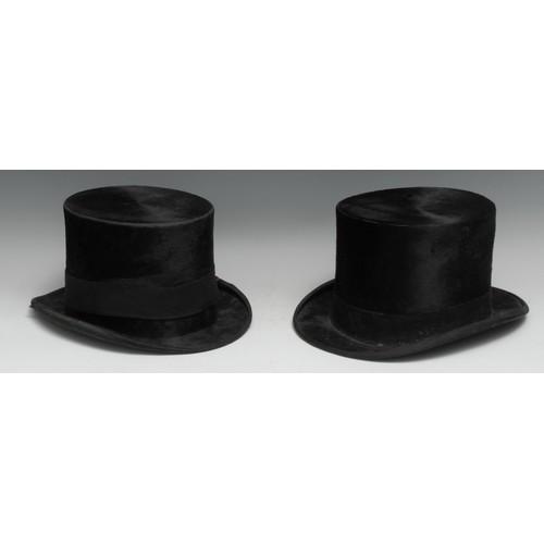 3184 - A gentleman's black silk top hat, by Austin Reed Ltd, Regent Street, London, inside dimensions 19.5c...