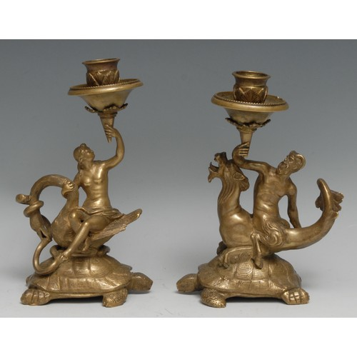 3341 - A pair of Renaissance Revival gilt bronze candlesticks, cast in the Mannerist taste with satyr and n...
