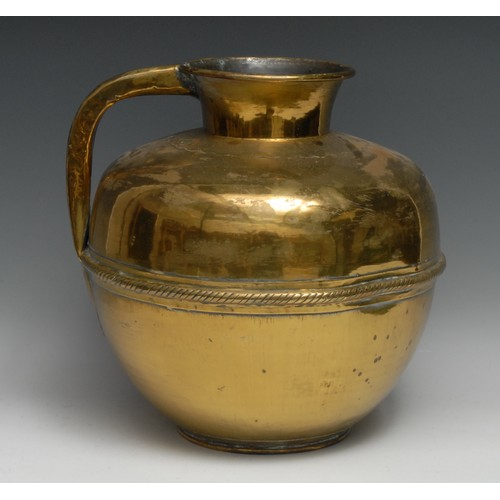 3232 - A large Middle-Eastern gilt brass ovoid ewer or your vessel, the waist applied with a rope twist gir...