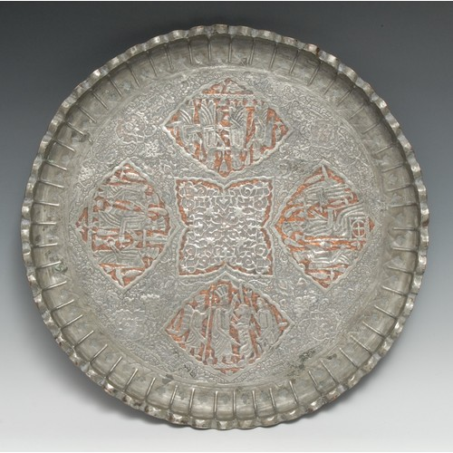 3276 - A Middle-Eastern tinned copper shaped circular tray, the field profusely chased in the Assyrian idio...