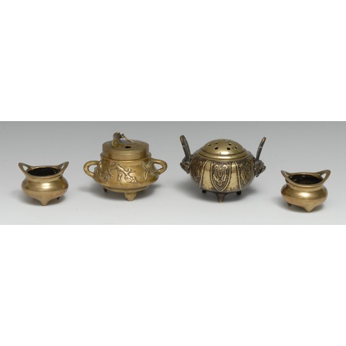 3123 - A Chinese bronze tripod censer and cover, cast in the Archaic manner with lappets and lion masks, 13...