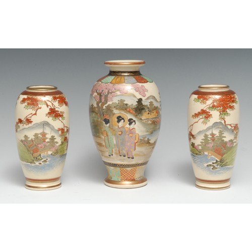 3216 - A Japanese Satsuma ovoid vase, typically painted and gilt with geishas in a landscape, 18.5cm high, ...