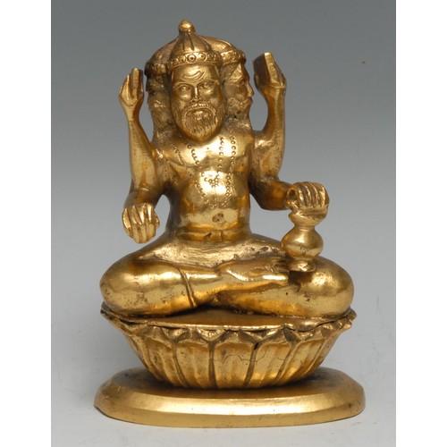 3632 - Indian School, a gilt-patinated bronze, of Brahma, 11.5cm high