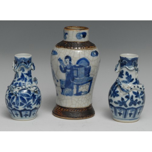 3385 - A small pair of Chinese porcelain baluster vases, applied with salamanders, painted in underglaze bl...