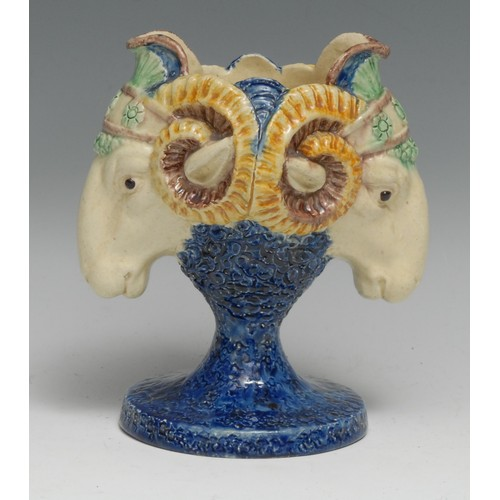 3082 - A 19th century Renaissance Revival majolica vase, boldly modelled with twin ram masks, glazed in the...