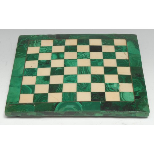 3258 - A malachite and marble chess board, outlined throughout with brass stringing, 20cm square