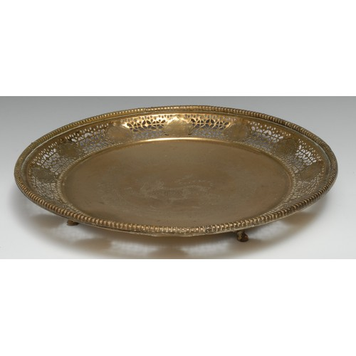 3128 - A Chinese circular brass table centre, engraved with a kylin within a border of lotus, pierced galle...