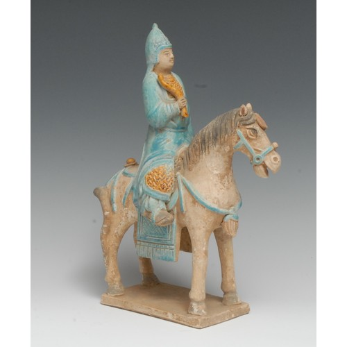 3160 - A Chinese terracotta equestrian figure, of an official on horseback, modelled in the Tang manner, pi...