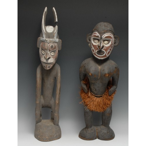 3856 - Tribal Art - a Papua New Guinea figure, she stands, her features decorated in white and earth pigmen...