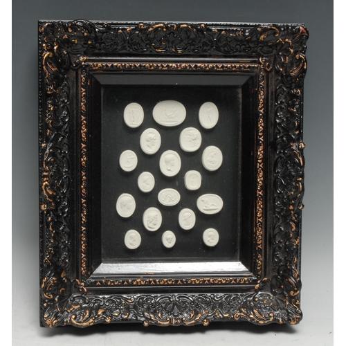 3461 - An arrangement of plaster intaglio impressions, various Grand Tour subjects, 19cm x 14cm, gesso fram...