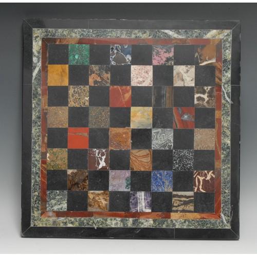 3355 - A pietra dura table top chess board, inlaid in lapis lazuli, malachite, amethyst quartz, agate and o...