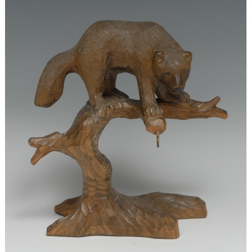 3102 - A Black Forest novelty pocket watch stand, carved as a bear upon the branches of a tree, 19cm high