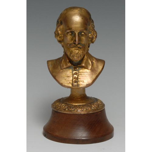 3490 - An early 20th century gilt metal library desk bust, of William Shakespeare, oak base, 16cm high
