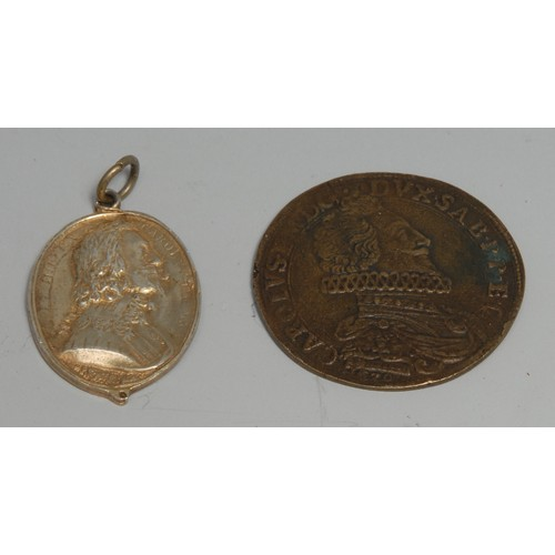 3636 - King Charles the Martyr - a silver-gilt coloured metal commemorative pendant medallion, in relief wi...