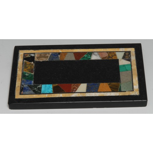 3352 - A pietra dura rectangular desk weight, the field inlaid with a band of turquoise, lapis lazuli, mala...