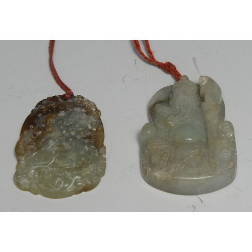 3145 - A Chinese jade tablet pendant, carved with an elder, 5.5cm long; another (2)